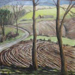 Winter landscape marked by the farmer's toil, roads meandering around undulating hills.